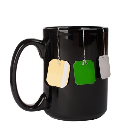 Cup with three tea bags photo