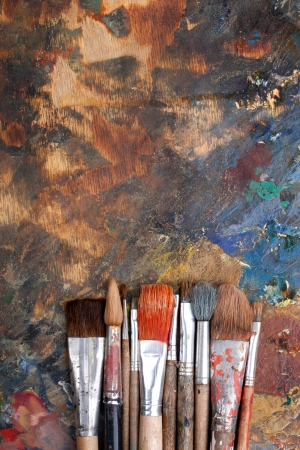 Abstract background with paint brushes photo