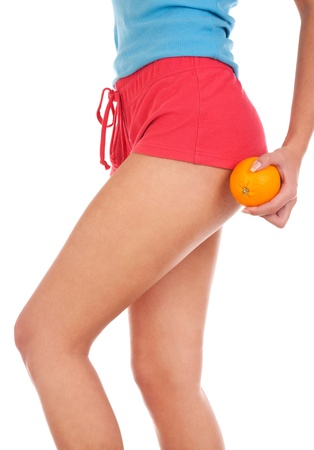 Beautiful female figure with an orange  photo