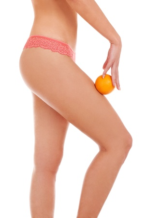 Belle figure de femme avec une orange photo