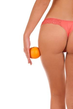 Beautiful female figure with an orange  Stock Photo
