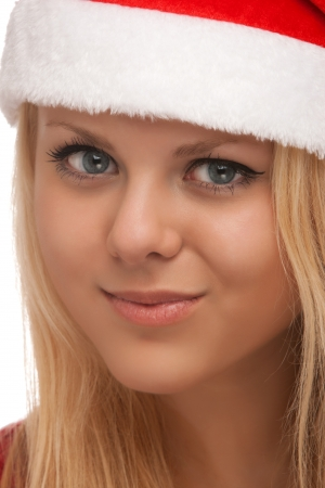 Young blond woman in santa hat photo