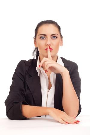shushing: Business woman shushing