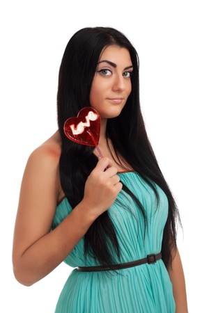Girl holding heart candy photo