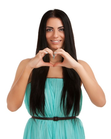 Young woman forming heart shape with hands Stock Photo - 17219015