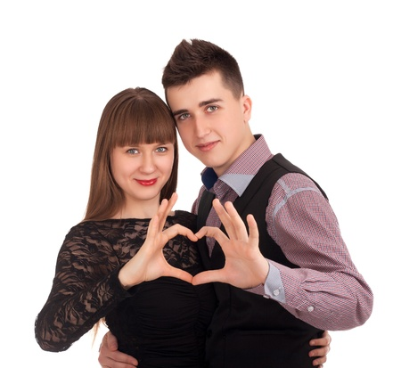 Happy couple showing heart with their fingers Stock Photo - 17231378