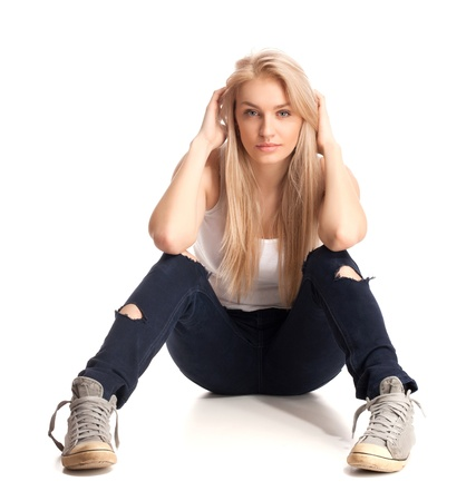 Blond teenage girl sitting photo