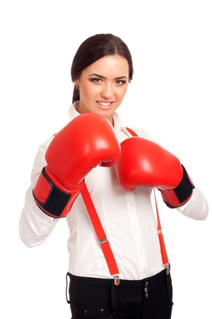 Portrait of business woman wearing boxing gloves photo