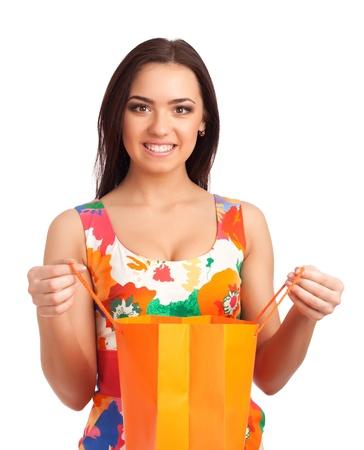 Beautiful woman holding shopping bag photo