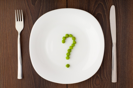 questions: Question mark made of peas on plate