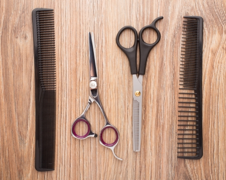 Barber accessories on wooden table photo