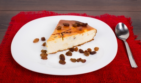Cottage cheese pie with raisins on a plate photo
