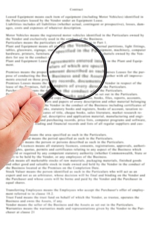 Hand holding magnifying glass reading important  document Stock Photo