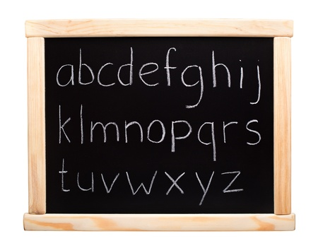 Alphabet written with chalk on blackboard photo