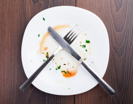 dinner plate: Empty plate left after dinner. View from above. Stock Photo