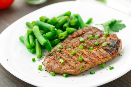 Delicious beef steak with green beans on a plate Stock Photo - 23167917