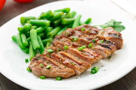 seared: Delicious beef steak with green beans on a plate