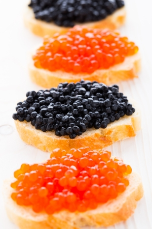 Sandwiches with black and red caviar on a bread Stock Photo