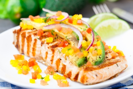 Avocado lime salmon with diced vegetables on a plate photo
