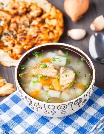 Fish soup with potato and rice in a bowl photo