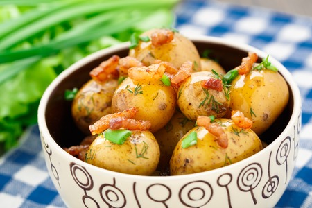 Potato with bacon and herbs in a bowl
