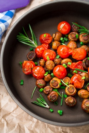 buttom: Roasted mushrooms with cherry tomatoes in a pan