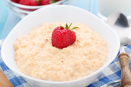 Healthy homemade oatmeal with strawberries for breakfast
