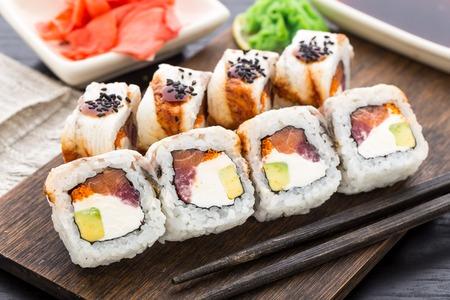SUSHI: Sushi roll with salmon, tuna and eel Stock Photo