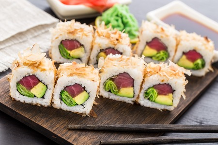 Sushi roll with tuna, avocado and lettuce
