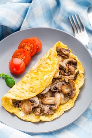 omlet: Homemade omelette with mushrooms on a plate