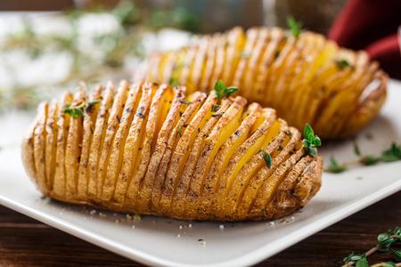 prepared potato: Hasselback potatoes Stock Photo