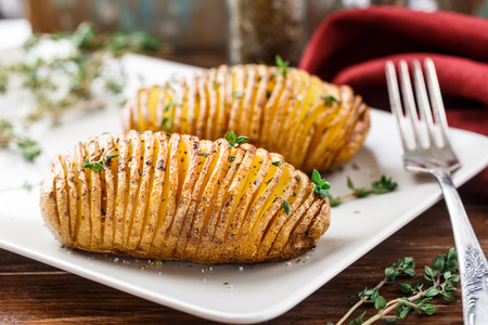 garlic: Hasselback potatoes Stock Photo