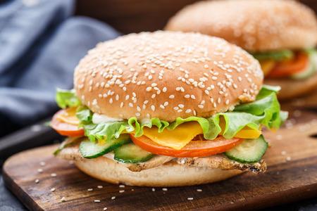 chicken burger: Cesare burger on wooden board