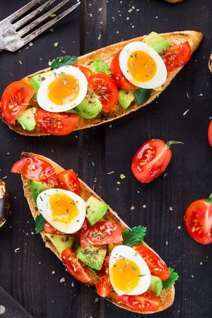 quail egg: Bruschetta with tomato, avocado and quail egg