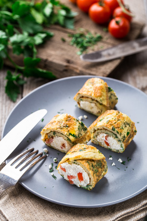 omlet: Omelette rolls with curd