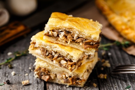 button mushrooms: Delicious homemade pie stuffed with button mushrooms Stock Photo
