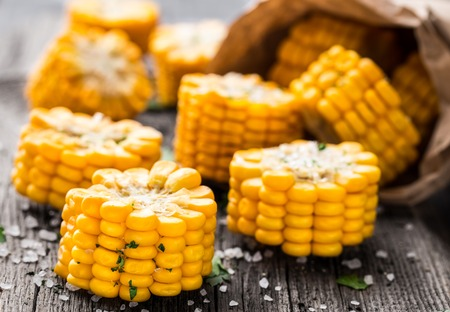 corn: Delicious grilled corn on a wooden board Stock Photo