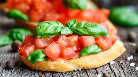 hero sandwich: Tomato bruschetta with chopped tomatoes and basil on toasted bread