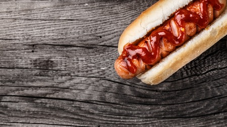 Barbecue grilled hot dog on a wooden board