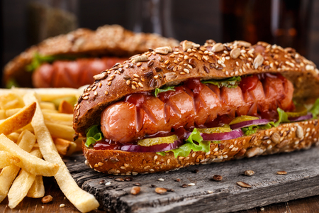 hot sauce: Barbecue grilled hot dog with french fries Stock Photo