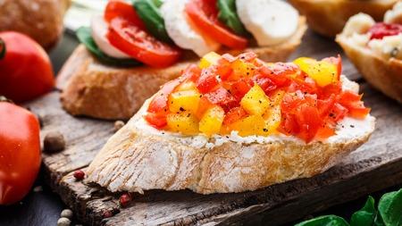 crusty: Italian bruschetta with chopped tomatoes, herbs and oil on toasted crusty ciabatta bread Stock Photo
