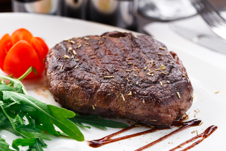beefsteaks: Grilled beefsteak on a plate Stock Photo