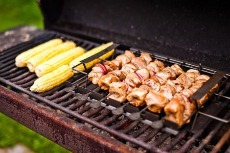 Barbecue meat and corn Stock Photo