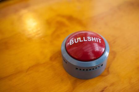 Bullshit knop om te drukken en te luisteren Stockfoto