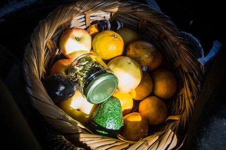 Fruit basket isolated under the sun with oranges Stock Photo