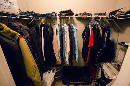 Closet of a man with shirts and suit inside
