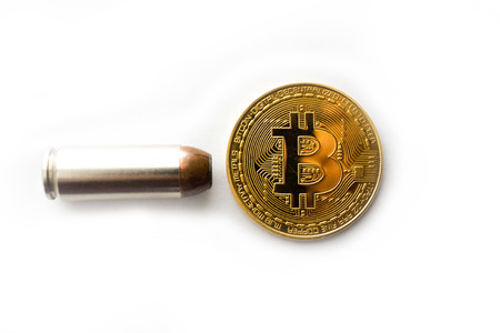 Bitcoin with bullet on white background close up Stockfoto