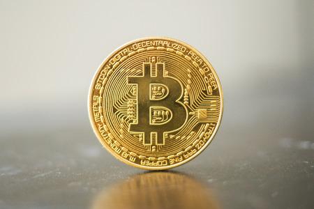 Single bitcoin front coin on grey background Zdjęcie Seryjne
