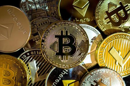 Bitcoin, litecoin, etherium coins close up dark theme