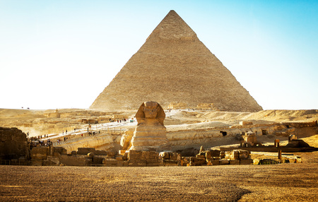 Egyptian sphinx with a ptramid in background at sunset 写真素材 - 95144347